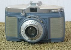 The beautiful Bilora Bella 46 is a 127 film camera  with a fabulous blue, gray and silvery color scheme.  Its a metal bodied camera with an