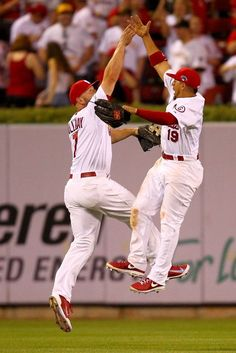 Matt Holliday and Jon Jay celebrate the Cardinals 9-1 victory against the Pittsburgh Pirates during Game 1 of the NLDS.  Cards won 9-1.  10-03-13
