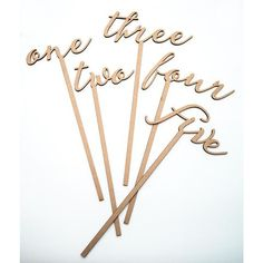 These word table numbers on sticks are perfect for your romantic wedding centerpieces. Precision cut in beautiful wood with dark burned edges for a rustic and elegant touch, these script word table nu