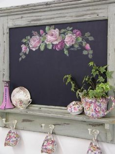 tea cup collection using a chalkboard display shelf - love the plant in the tea pot