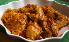 There are so many versions of Poulet a L'Haitienne, Chicken in Creole Sauce, or Poule en Sauce and many names for a simple chicken dish. In the Haitian culture it is very common for a dish to have several names depending on which part of the country a per Creole Recipes, Cajun Recipes, Chicken Recipes, Cooking Recipes, Louisiana Recipes, Donut Recipes, Chicken Creole Recipe, Cajun Food, Turkey Recipes