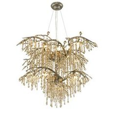 """Inspired by a forest canopy, this beautiful mystic gold-finished chandelier perfectly pairs natural appeal with a shimmering crystal design.   Product: ChandelierConstruction Material: Steel and crystalsColor: Mystic goldFeatures: Organic branchesAccommodates: (18) 20 Watt G4 halogen bulb - includedDimensions: 27.5"""" H x 40"""" W"""