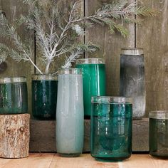 Pretty glass jars and vases in the same color family would spice up a wooden table...