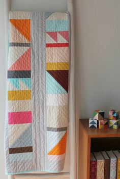 Modern baby quilt--bright geometric design by BrigitGail on Etsy