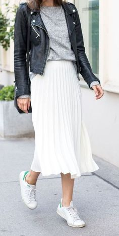 pleated skirt. sneakers. adidas. leather jacket. fall street style.