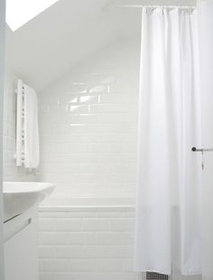 In a perfect world all houses have walk-in closets, food pantries, adequate shoe storage and bathrooms without wonky design challenges like this one where a sloped ceiling keeps the shower curtain rod from spanning the full length of the tub. How would you conquer this shower curtain conundrum? Turns out the answer only costs a few pennies!