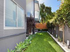 Low maintenance garden design using grass with retaining wall & ground lighting - Gardens photo 277166