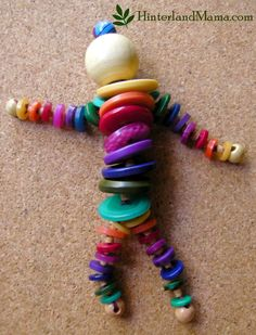 Hinterland Mama: Thought I'd make a Rainbow Button Doll, from repurposed craft items