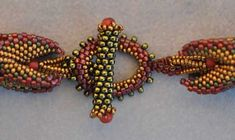"""""""Dragon Claws,"""" a transition from the spiral to the loop and toggle clasp, learned from a kit by Laura McCabe,"""