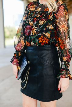 Love the pattern of this top. Vibrant! Great outfit paired with the leather skirt to make it edgy!
