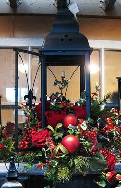 lantern with Christmas greenery and ornaments