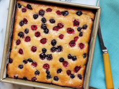 Get Honeyed Lemon-Berry Snack Cake Recipe from Food Network -- with a few tweaks this could be paleo.
