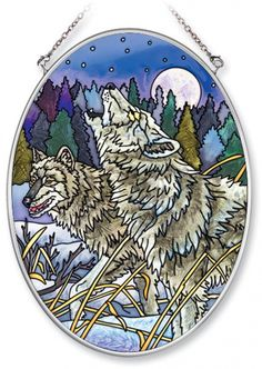 This beautiful medium oval Howling in the Moonlight Wolf Stained Glass Suncatcher is hand-painted with vibrant colors to brighten up any room!The shiny metal chain makes hanging this suncatcher a bre
