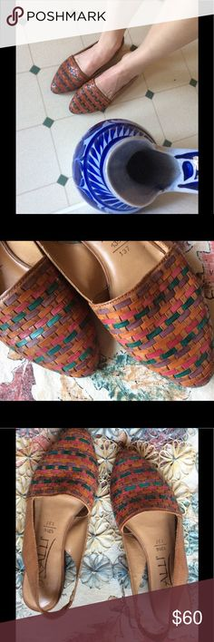 Vintage Weaved Leather Rainbow Brazil Flats KALLI Excellent condition. Smoke-free home. Genuine leather upper. Made in Brazil. Light brown face. Purple orange rose red and green almost teal colors. Multi colored work or summer vacation shoes. Funky and classy. Mini kitten point. Tiny half inch heel. Straps around ankle. Fantastic! Collectible. Bohemian chic. Boho. Gypsy. Music festival. Don't hurt your feet and still look like a peace hippie. Or wear to work. Versatile. No scratches or…