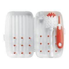 OXO Tot On-The-Go Drying Rack and Bottle Brush, Orange (719812933092) Compact, all-in-one cleaning solution perfect when away from home Bottle brush with silicone detail cleaner and bottle brush stand fit securely inside drying rack Flexible tines elevate bottles, nipples and breast pump parts to allow for ventilation Rib pattern wicks away water and provides ample space for drying Ideal for drying bottles, sippy cups, breast pump parts and more