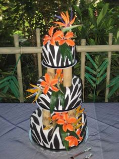 """cool """"bamboo"""" cake pillars! I love the bright tropical flowers too."""
