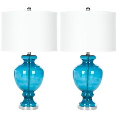 Inspired by collectible colored glass vases and bottles, the translucent turquoise glass table lamp is a perfect accessory for coastal and cottage style interiors. Silver fittings and off-white cotton hardback drum shade update the romantic vintage l Table Turquoise, Turquoise Glass, Light Turquoise, Bedroom Turquoise, Turquoise Fabric, Buffet Chic, Clear Glass Table Lamp, Glass Lamps, Feng Shui