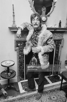 John Lennon (1940 - 1980) wearing an afghan coat and a sporran at the press launch for the Beatles' new album 'Sergeant Pepper's Lonely Hearts Club Band', held at Brian Epstein's house at 24 Chapel Street, London, 19th May 1967.