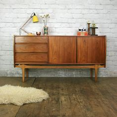 A beautifully designed & crafted, petite teak sideboard manufactured by Nathan of Great Britain circa 1960s.