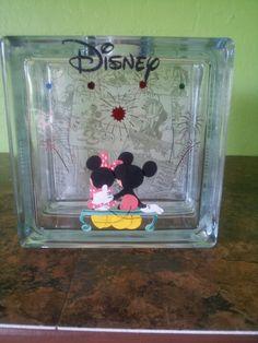 Saving for Disneyland ...made glass block to put money in.