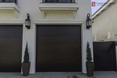 Huge selection of Custom Wood Garage Doors. Tungsten Royce manufactures the finest custom wood garage doors in southern California. Contemporary Garage Doors, Modern Garage Doors, Modern Contemporary, Custom Garage Doors, Wood Garage Doors, Side Gates, Garage Door Installation, Spanish Colonial, Custom Wood