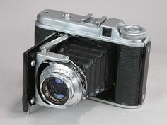 The Perkeo II was a medium format roll film folding camera made by Voigtländer and produced between 1952-55. 'Perkeo' means a pigmy. The Perkeo cameras were very compact and light cameras for use of medium fomat true to Perkeo's name. They are arguably the smallest 6x6 folder. The Perkeo II was the second of three Perkeos. This model was distinguished by a frame counter and a wind-on locking mechanism. Almost all Perkeo IIs came with Voigtlander's coated Color-Skopar lens.