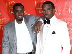 Celebrities with their wax figures. This is crazy
