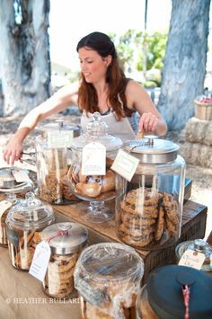 Sweet Pea Bakery - love the name, love the display, and love the food.....this would be a great idea for farmer's market. The huge glass cookie jars with the huge cookies look so tempting. I bet you would sell a lot!