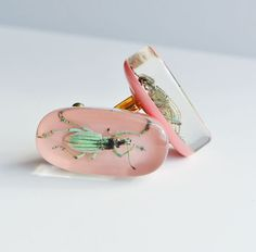 Pink lucite cufflinks with real insects. $30.00, via Etsy.