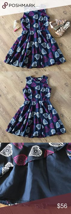 """Navy print sleeveless dress Navy blue with magenta and white/slightly off white pattern. Sleeveless with zip up back. Navy blue lining. 100% polyester. Bust (laying flat) 16"""". Length 32"""".  Please ask any necessary questions prior to purchasing. No trades. Save even more with a bundle discount! Maison Jules Dresses"""