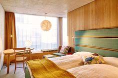 """Das erste Apartmenthaus der Stadt, ein Neubau aus Beton und ein welterprobtes Interior: Das """"Nomad Hotel"""" in Basel."""