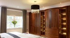 Lovingly crafted wardrobe in a luxuriously designed bedroom.