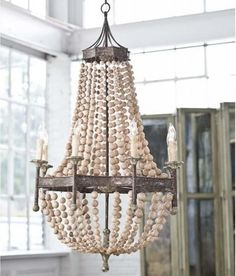 Interior HomeScapes offers the Wood Beaded Chandelier by Regina Andrew Design. Visit our online store to order your Regina Andrew Design products today. Nautical Chandelier, Wood Bead Chandelier, Chandelier Lighting, Empire Chandelier, Shell Chandelier, Chandelier Ideas, Pendant Lights, Circular Chandelier, Shabby Chic Chandelier