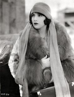Bebe Daniels. Fur coat, scarf and a hat, she's prepared for Hollywood weather! Fab makeup.