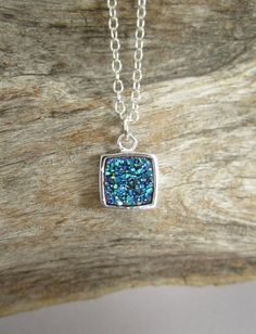 Super sparkly, bezel set, druzy quartz gemstone hangs freely on a sterling silver cable chain.
