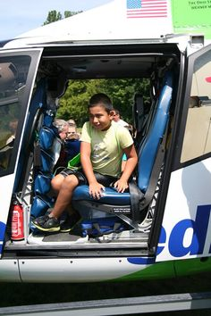 Exploring the helicopter from one of our local superheros with Life Flight.  HomeCare Matters Super Hero Children's Grief Camp.