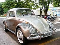 Classic VW Bug with whitewalls and my preferred way to see two tone dine . . . very nice.