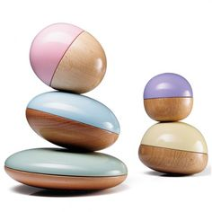 Magical Beans - Half gorgeous beach wood grains, half bright color, each of these 'beans' features an enclosed, offset steel ball that gives it unique balancing properties. Stacking them becomes a Zen, artistic challenge.