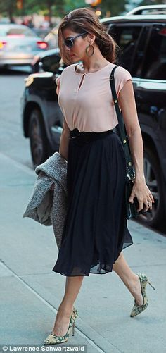 Eva Mendes wore a full skirt and pink top, a Marni bag and Bionda Castana heels. #celebrity #streetstyle