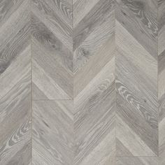 The Chevron pattern originated in century France where it adorned the palaces of Kings and nobility alike. With the resurgence of pattern being used in all types of home interiors and fashion it is no surprise that this classic pattern would make a r Mannington Laminate Flooring, Herringbone Laminate Flooring, Laminate Wall, Hardwood Floors, Wood Flooring, Basement Flooring, Chevron, Flooring Store, Remodels And Restorations