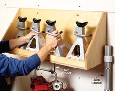 Jack and jack-stand holder  Free up floor space by storing your jack stands in this wall-hung holder. Then hang up your lightweight floor jack underneath.