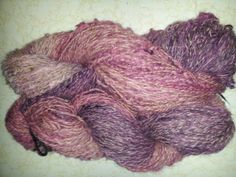 Alpaca and chiengora plied with cotton.  Dyed purple to pink