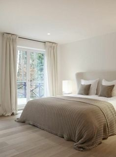 This serene taupe and white contemporary bedroom would be a perfect scheme during the warmer months. This serene taupe and white contemporary bedroom would be a perfect scheme during the warmer months. Bedroom Red, Dream Bedroom, Home Bedroom, Master Bedroom, Bedroom Decor, Taupe Bedroom, Bedroom Curtains, Calm Bedroom, Serene Bedroom