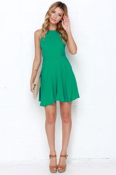 We know you scored a ten out of ten before you even set foot on the dance floor in the West Coast Swing Green Skater Dress! Lightweight rayon in a bright hue begins at a cute squared-off neckline, fastening with a small button above two back panels and cutout. Fitted waist is framed by a darted bodice, leaving the full, flirty skater skirt to accentuate those captivating spins! Exposed gold zipper at back. Fully lined. Self: 100% Rayon. Lining: 100% Polyester. Machine Wash Cold or Dry Clean.