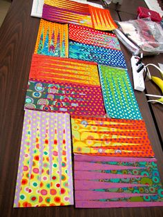 Canton Village Quilt Works - Stepping Stones with Kaffe Fassett Design rolls, Aboriginal Dots and Spots. I actually purchased a copy of this pattern a couple years ago, and love seeing it done in these bright colors. Colorful Quilts, Small Quilts, Quilting Projects, Quilting Designs, Sewing Projects, Skinny Quilts, Quilt Modernen, Foundation Paper Piecing, Contemporary Quilts