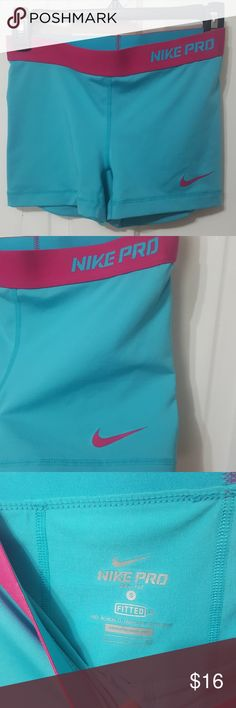 Nike Pro Fitted Shorts Nike Pro fitted running shorts. Dri-Fit. Teal shorts with hot pink accents. These shorts would look super cute with the Nike tank top that is also in my closet. Size Small Nike Shorts