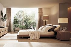 Poliform bed and furniture. Would love to know whose floor standing lamp that is...