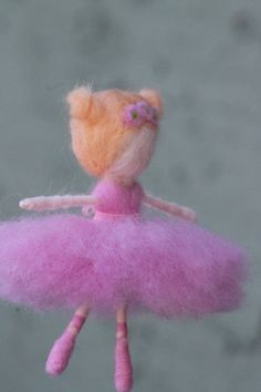The perfect gift for your little ballerina! You can customise this needle felted ballerina ornament to look just like your ballerina. Pick hair color and style as well as dress and shoe color. Her arms and legs have wire in them which allows you to gently move them into different positions. Can also be made into a mobile. The ballerina pictured is approximately 4inches tall and comes with monofilament for hanging. Please message me to order you custom ballerina today