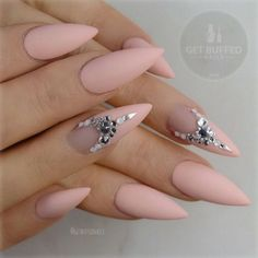 Embellished nude pointy nail design