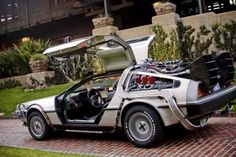 The Time Machine/DMC DeLorean (Back To The Back To The Future Part II- Back To The Future Part This is the holy grail of all cars on the planet. My favorite car in the whole world and it still turns heads 27 years later. Dmc Delorean, Delorean Time Machine, The Time Machine, Back To The Future, Future Car, Mad Max, Dodge Challenger, My Dream Car, Dream Cars